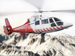 Medical evacuation helicopter in flight over snow capped mountains
